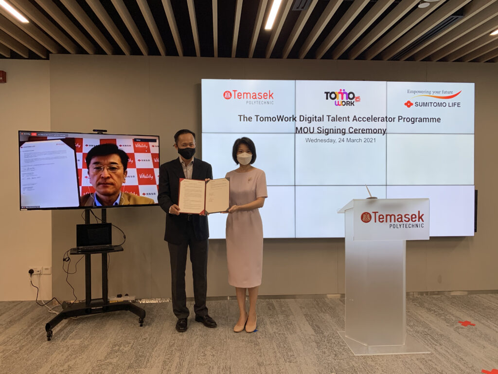 MoU signing between Mr Toru Shiomitsu (Sumitomo Life Insurance) and Mr Peter Lam (Temasek Polytechnic) with Ms Sun Xueling, Minister of State in Education and Social & Family Development